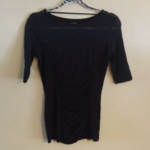 INC black sheer and jersey rushed top.